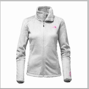 white North Face jacket with breast cancer pink